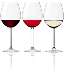 Three glasses with stained, pink and white wine.